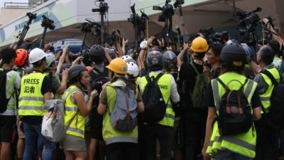 維護新聞自由,記者的合法採訪活動不受暴力干擾,才能確保香港社會文明不倒退。(亞新社)