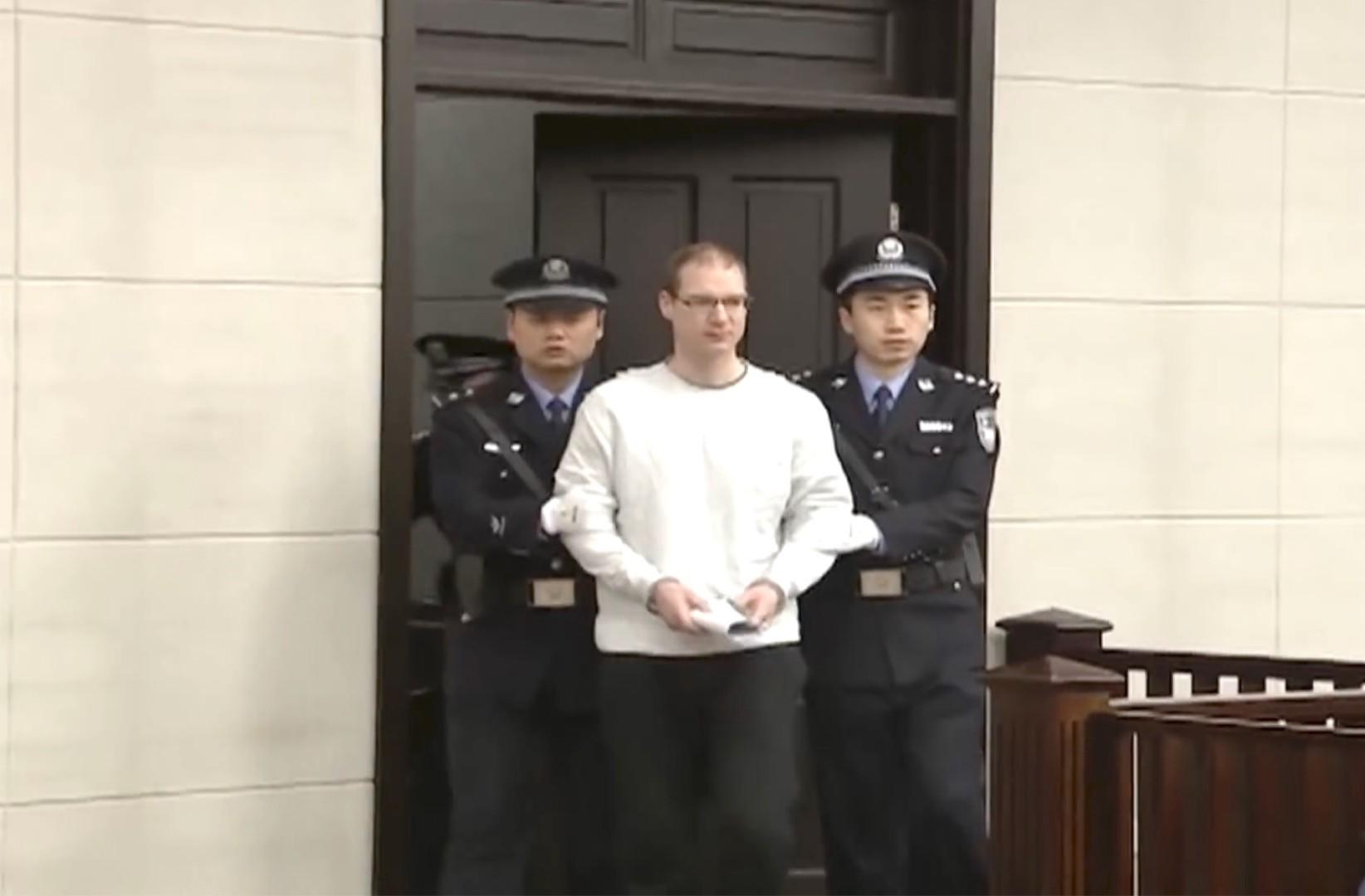 中國堅決否認拘禁加拿大人是「人質外交」。(亞新社)